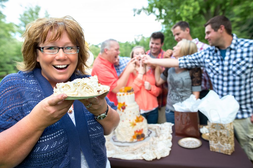 Woman eating cake at an outdoor party