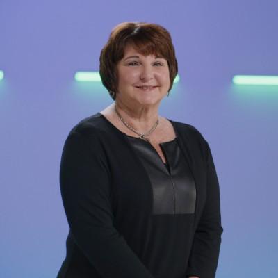 Female cancer survivor in black shirt smiling