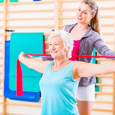 Senior woman working with physical therapist