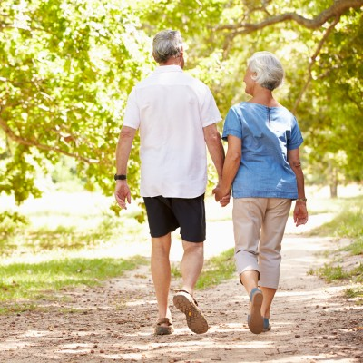 Senior couple walking on outdoor trail