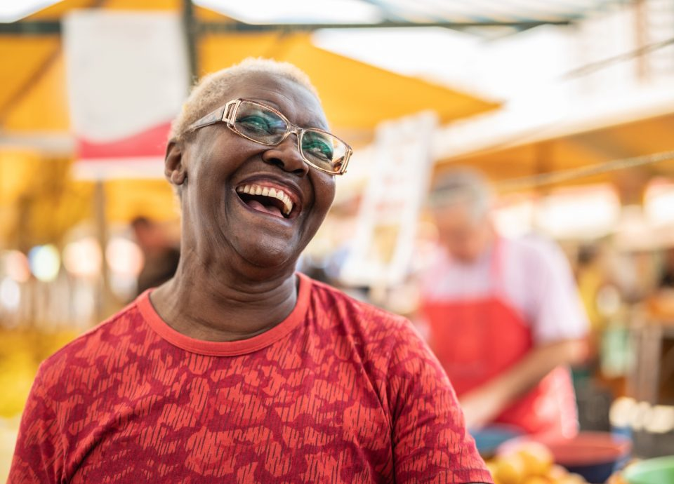 Laughing senior woman in red shirt