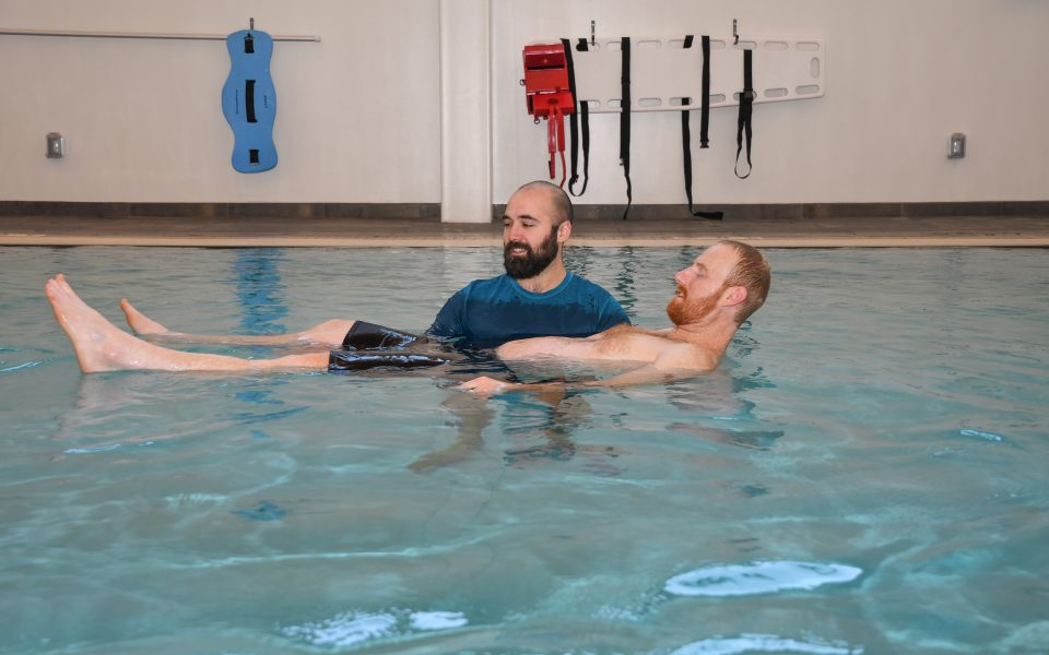 physical therapist with aquatic therapy patient