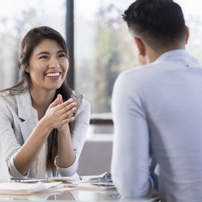 Cheerful buisnesswoman meets with man