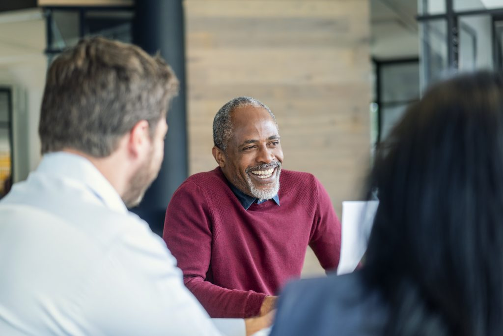 African American man smiling in a meeting