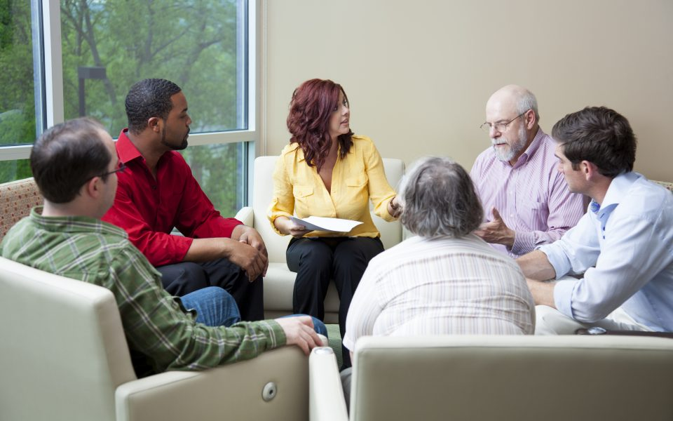 Men and women discussing in a support group