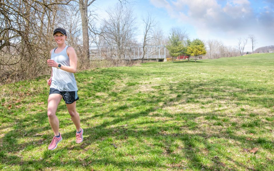 Young female cancer survivor running in a park