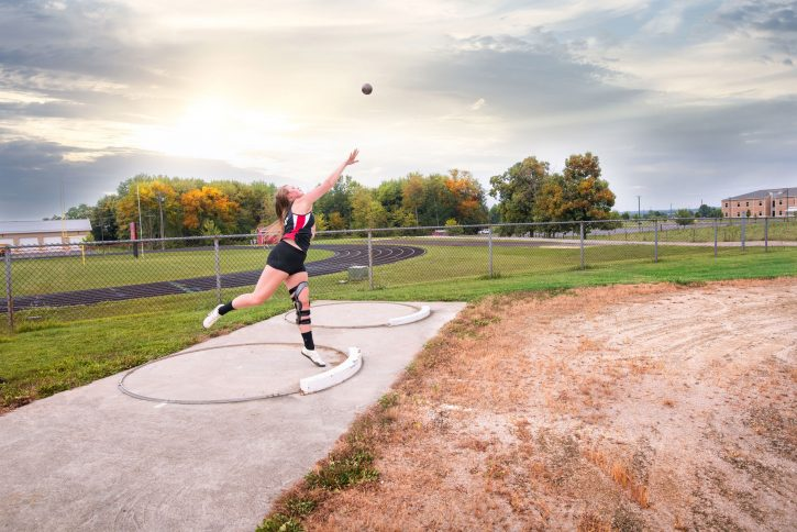 Brittany Devaull thowing a shot put