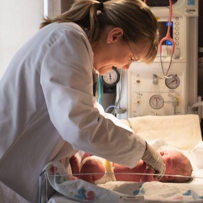 Pediatrician, Dr. Robertson with newborn