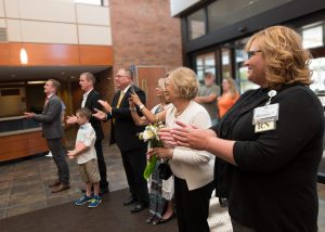 Emergency Department manager Angela Snider (far right) applauds with members of the Van Camp family as Paul Van Camp's name is revealed in the lobby on June 14.