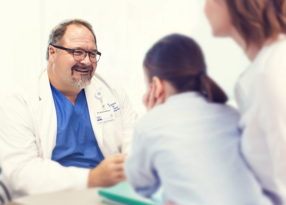 Surgeon speaking with patients