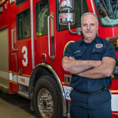 Fire fighter standing in front of fire truck