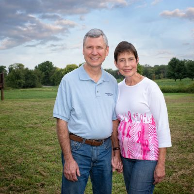 Breast cancer survivor smiling with her husband outside