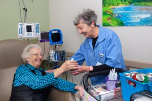 Volunteer helping cancer patient during treatment