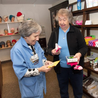 Volunteer assists patient at the Cancer Resource Center