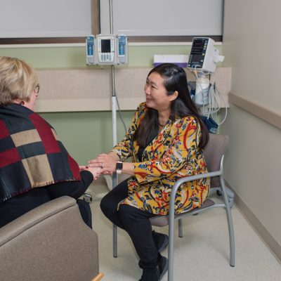 Oncology social worker comforting female cancer patient