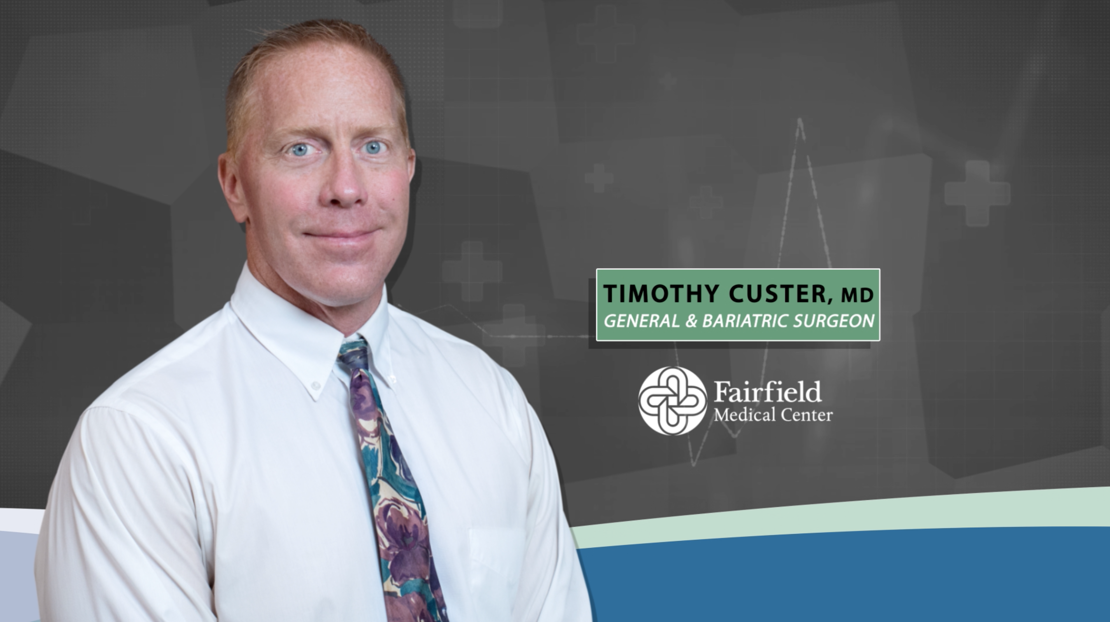 Timothy Custer, MD stands against grey background