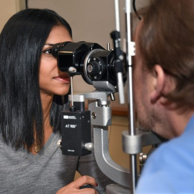 Ophthalmologist examining patient's eyes