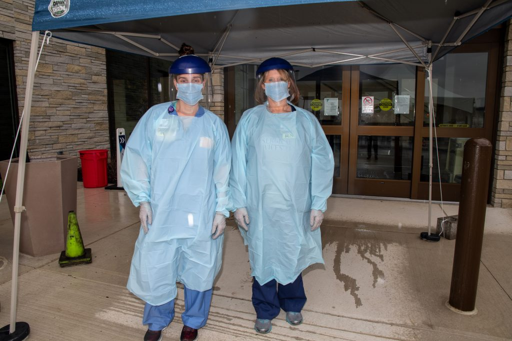 two nurses at covid-19 testing facility