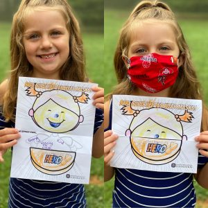 willow wearing a mask and holding coloring pages for friend of a hero campaign