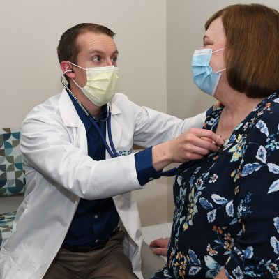 Provider checking patient's heart