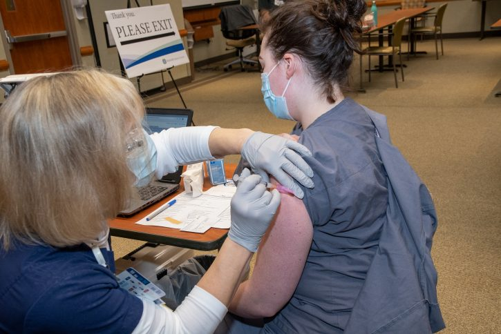 First staff member at FMC being vaccinated